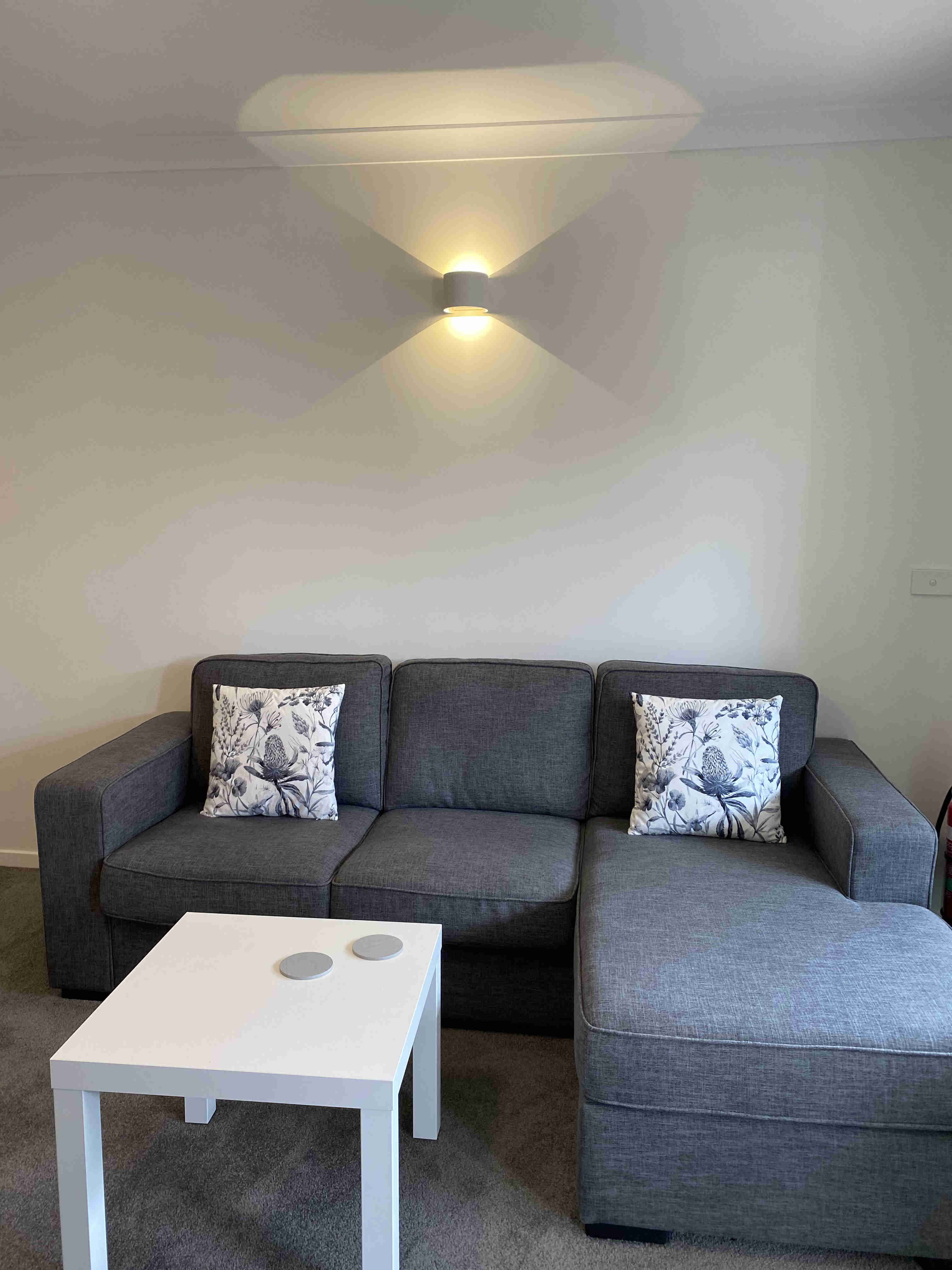 Chaise lounge suite and coffee table in one bedroom apartments