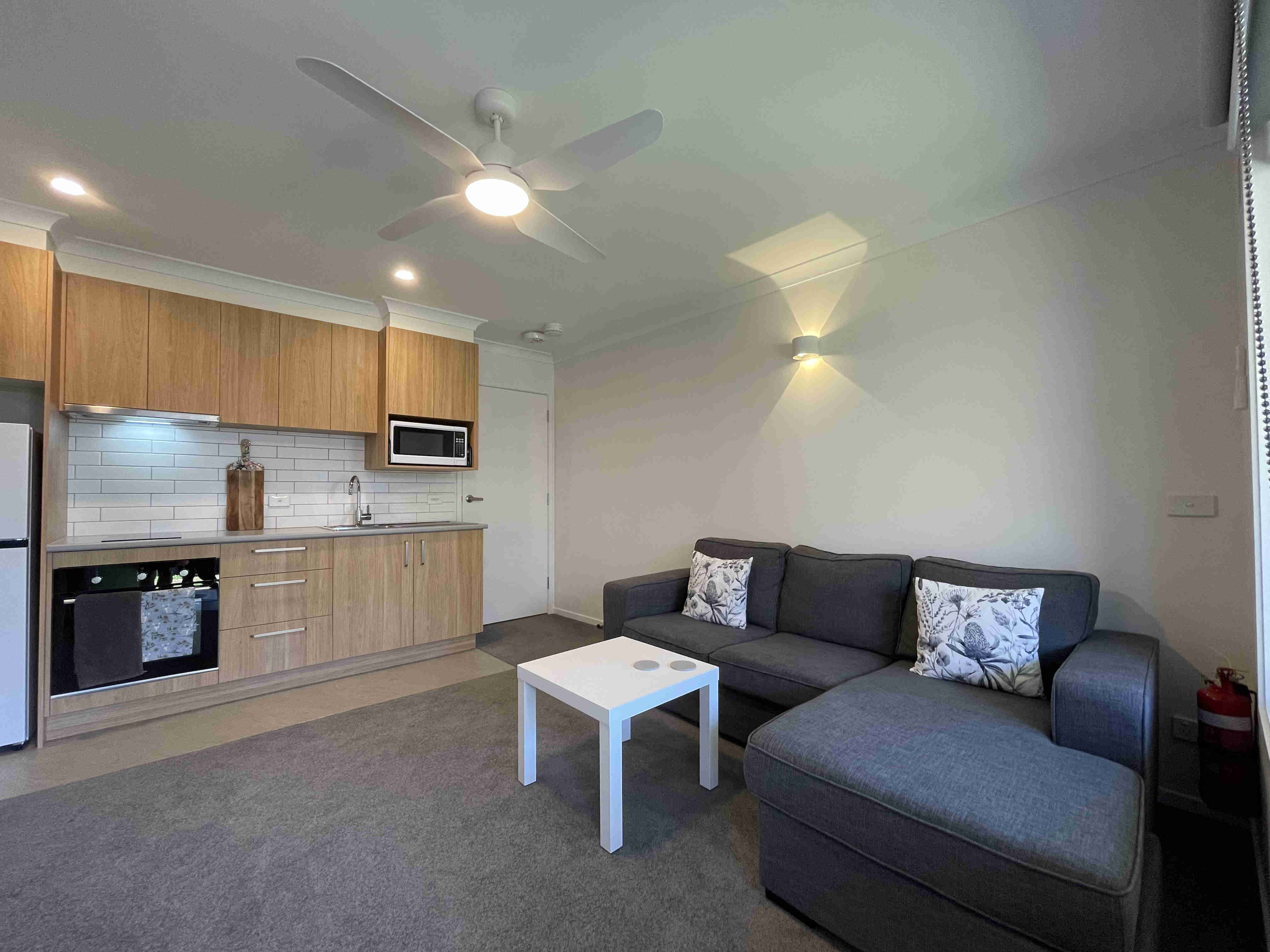 Lounge area and kitchen in one bedroom apartments with one king bed