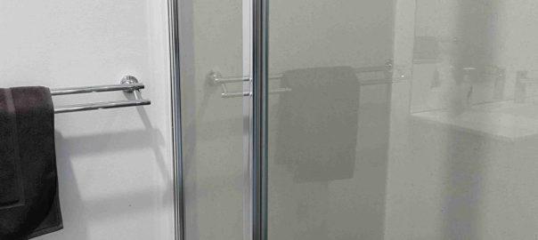 Shower in bathroom of small studio apartment