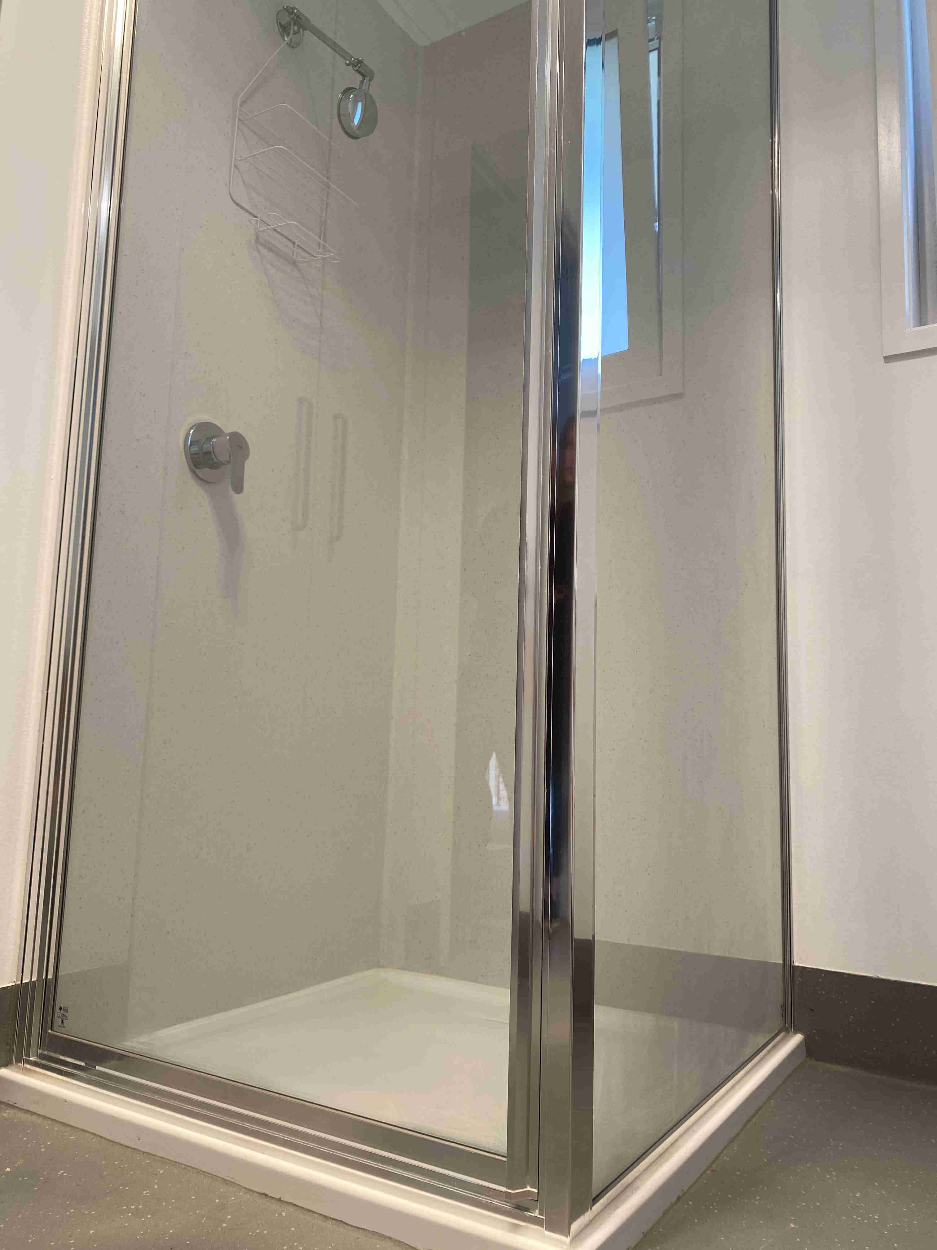 Shower in bathroom of one bedroom apartments