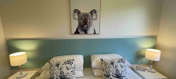 Bed with canvas of koala in all apartments