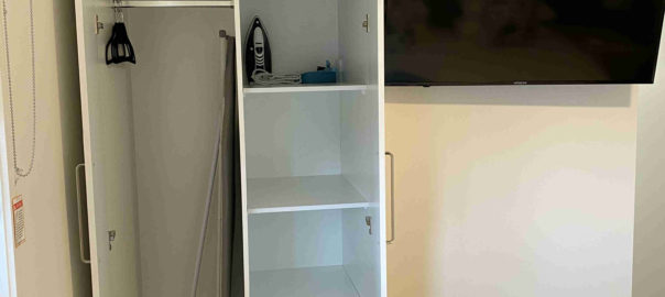 Wardrobe and smart tv in one bedroom apartments