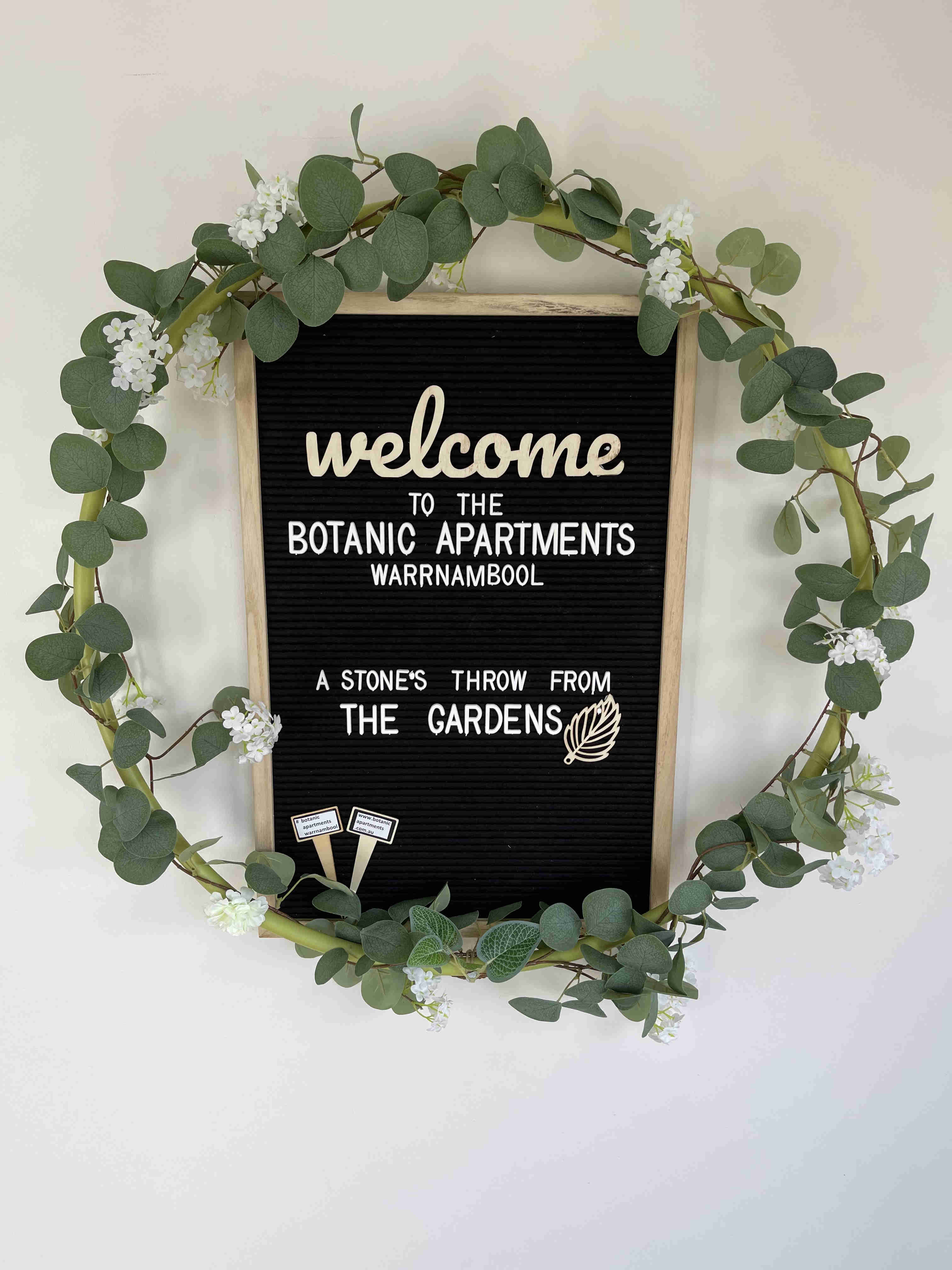 Welcome sign in reception entrance at Botanic Apartments, Warrnambool