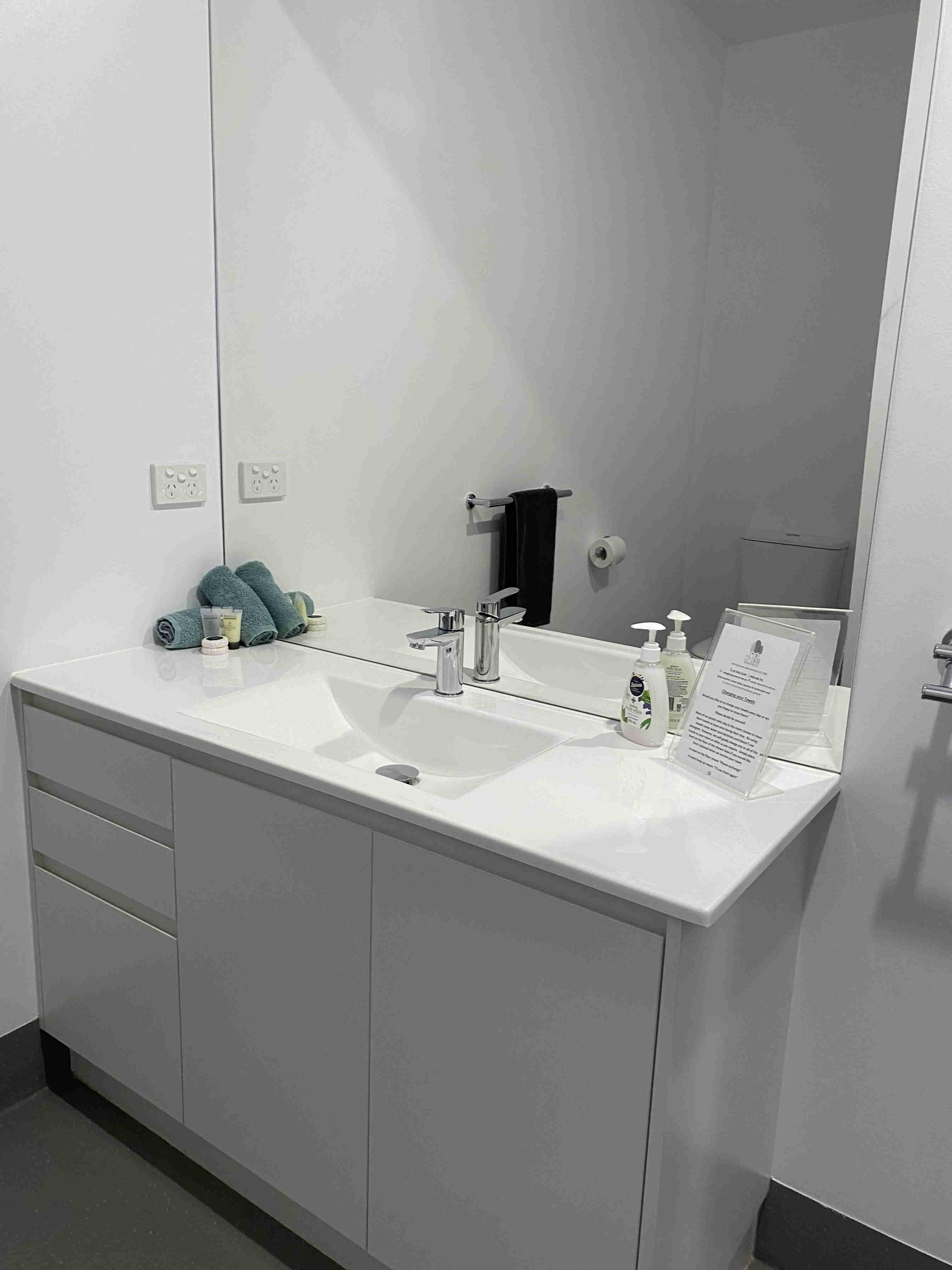 Vanity in bathroom of small studio apartment
