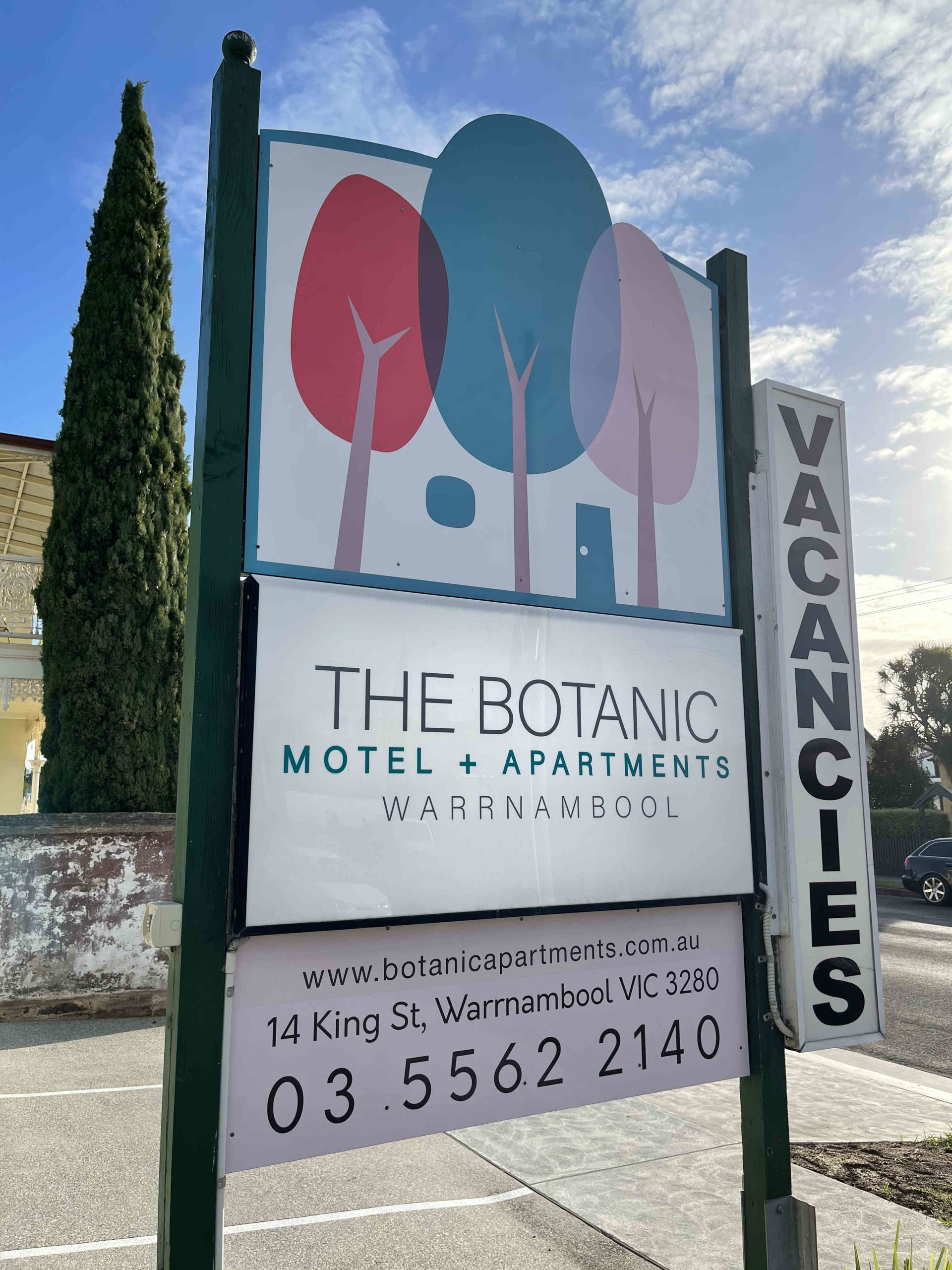Exterior sign at front of property of the botanic motel and apartments