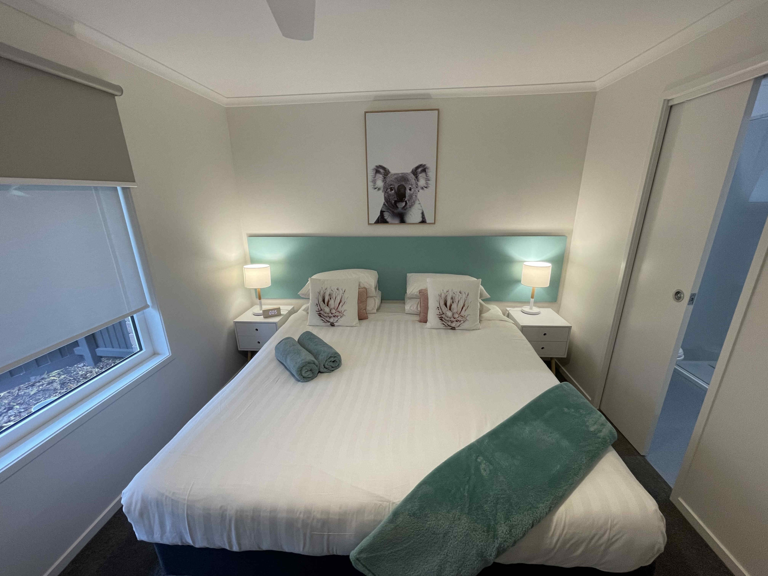 King bed in one bedroom apartment with a king and single bed